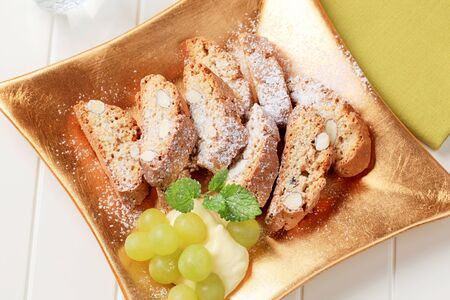 Traditional Italian almond biscotti with grapes and pudding Stock Photo - 10562538