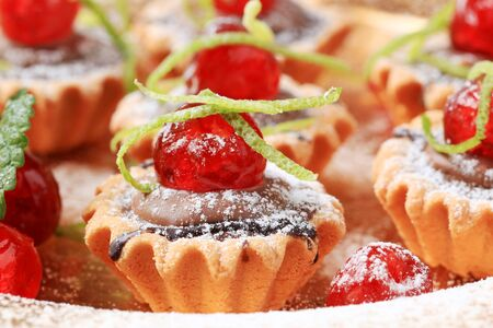 maraschino: Chocolate filled tartlets topped with maraschino cherries