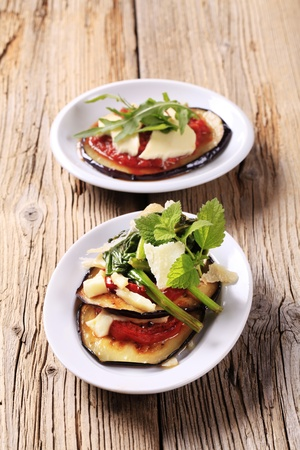Grilled aubergine and tomato sprinkled with cheese photo