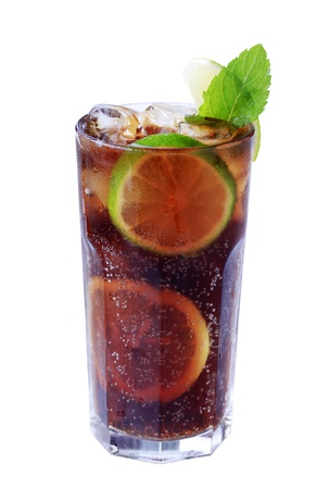 Tall glass of iced drink with slices of lime photo