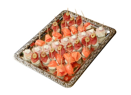 Variety of bite-sized canapes on a tray Stock Photo