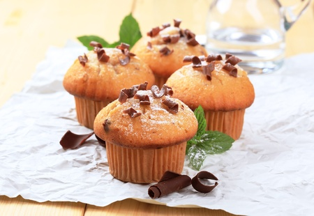 shavings: Tasty muffins topped with chocolate shavings - detail