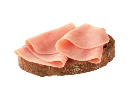 ham: Dun gesneden ham op bruin brood Stockfoto
