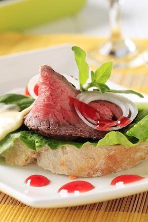 Detail of open faced roast beef sandwich  photo