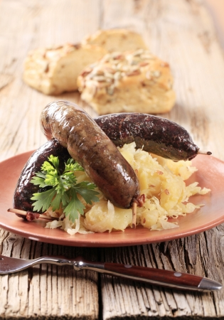 Blood sausage and white pudding with sauerkraut and potatoes Stock Photo - 10818393
