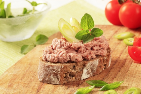 Slice of brown bread and meat spread