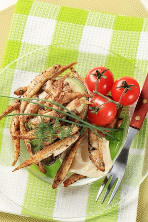 Fried anchovies with avocado fruit and homemade mayo photo