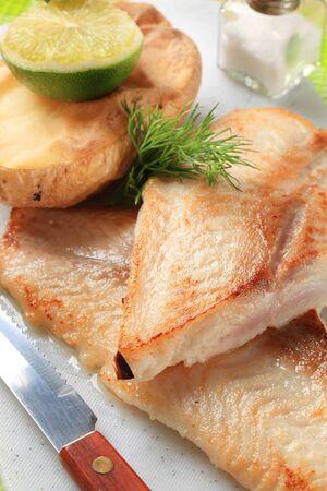 haddock: Pan fried white fish fillets with potato Stock Photo