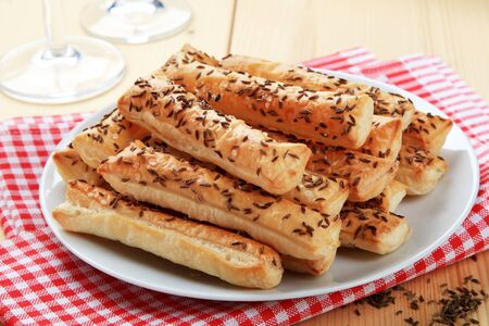 breadstick: Puff Pastry Straws with Caraway Seeds Stock Photo