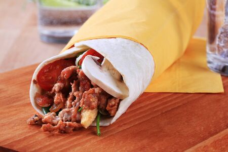 minced beef: Tortilla filled with ground meat - closeup Stock Photo