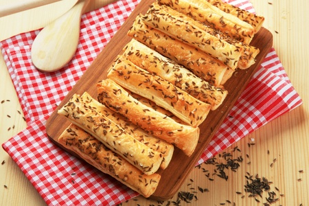caraway: Puff Pastry Straws with Caraway Seeds Stock Photo