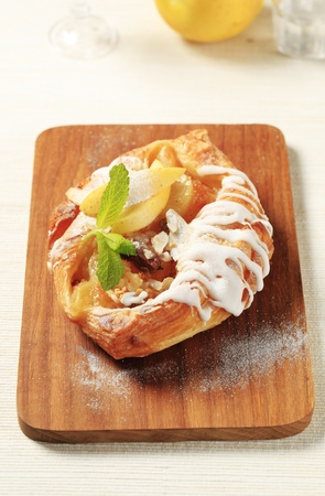 Danish pastry with apple filling and sugar icing Stock Photo - 11012698