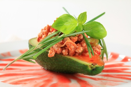 Avocado stuffed with stir fried minced meat photo