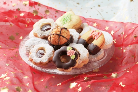 Variety of Christmas cookies on a festive tablecloth photo
