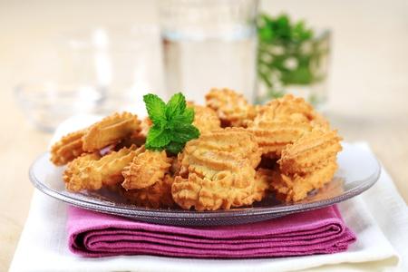 spritz: S-shaped Spritz cookies on plate - closeup