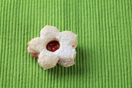 Jam filled cookie on a green napkin  photo