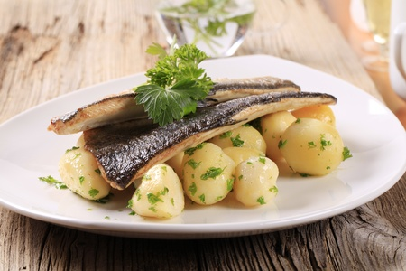 Pan fried trout with potatoes photo