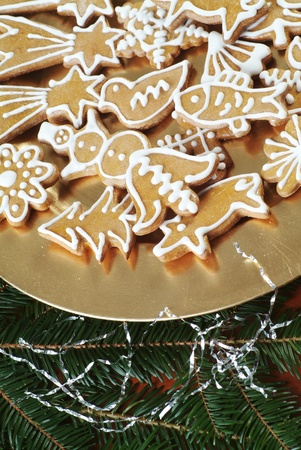 Christmas gingerbread cookies on a golden plate Stock Photo
