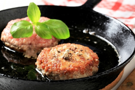minced beef: Detail of pan fried patties on a fry pan Stock Photo