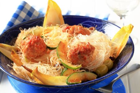 Dish of meatballs with cellophane noodles and vegetables photo