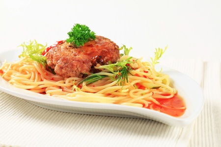 Meat patty with spaghetti and spicy sauce photo