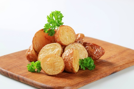 Oven-roasted new potatoes on a cutting board Stock Photo - 11301641