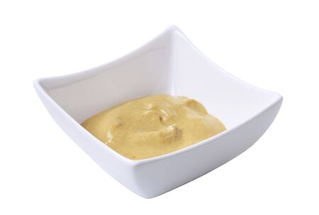 Spicy mustard in a small square bowl