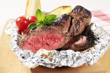 Roast fillet of beef on tinfoil Stock Photo