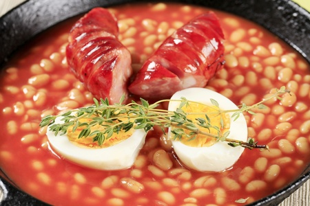 Baked beans and sausage in a fry pan photo