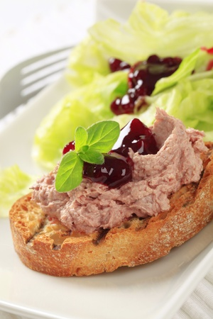 Toasted bread and pate with cranberry sauce and lettuce photo