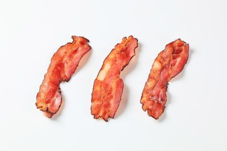 streaky: Crispy pan-fried strips of bacon Stock Photo