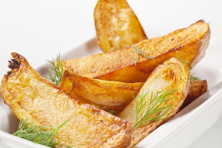 potato wedges: Roasted potato wedges garnished with fresh dill
