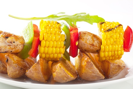 Shish kebab and potato wedges - detail photo
