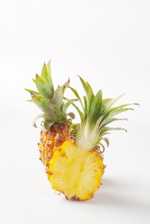 Fresh pineapple cut into halves - studio shot photo