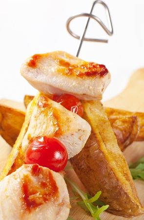 Chicken skewer and potato wedges - detail photo