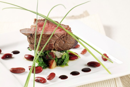 Roast beef and sauteeed spinach leaves Stock Photo - 11842753