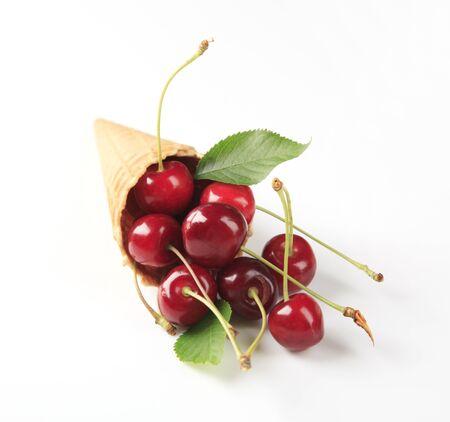 bing: Fresh red cherries in a cone - studio