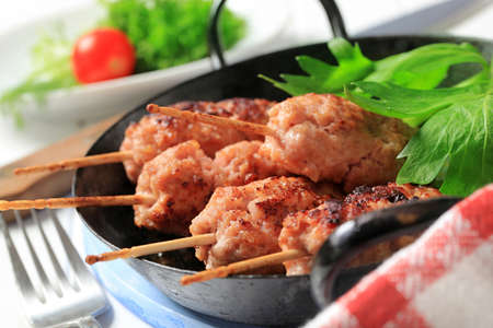 Minced meat kebabs on wooden sticks photo