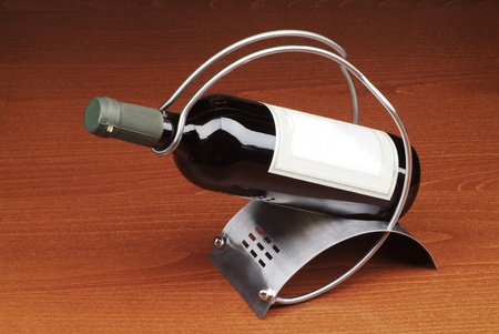 Bottle of red wine in a stand Stock Photo - 12183457