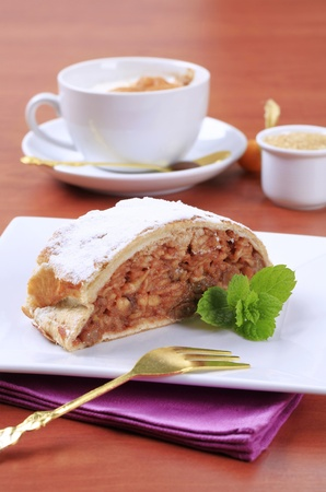 Slice of apple strudel and a cup of coffee photo