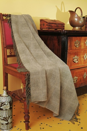 Ornamental antique furniture and a woven throw Stock Photo - 12183492