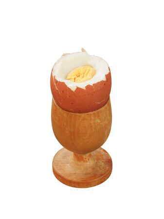 Boiled egg in a wooden eggcup photo