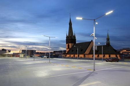 Empty car park illuminated by street lights photo