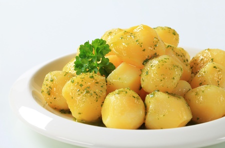 Cooked potatoes with butter and parsley Stock Photo - 12444033