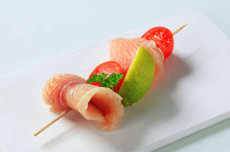 alaska pollock: Raw fish skewer on a cutting board Stock Photo