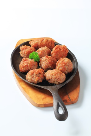 Meatballs on a cast iron pan photo