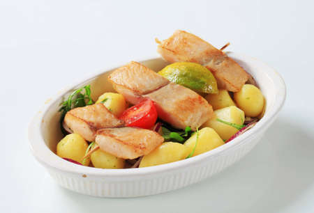 Fish skewer and potatoes in casserole dish Stock Photo - 12444072