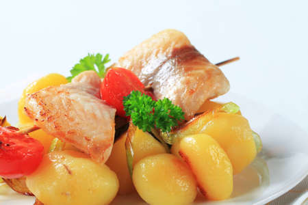 Fish skewer and potatoes - detail Stock Photo - 12444094