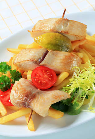 alaska pollock: Fish skewer and French fries - detail