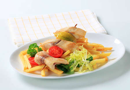 Fish skewer and French fries - studio Stock Photo - 12444098